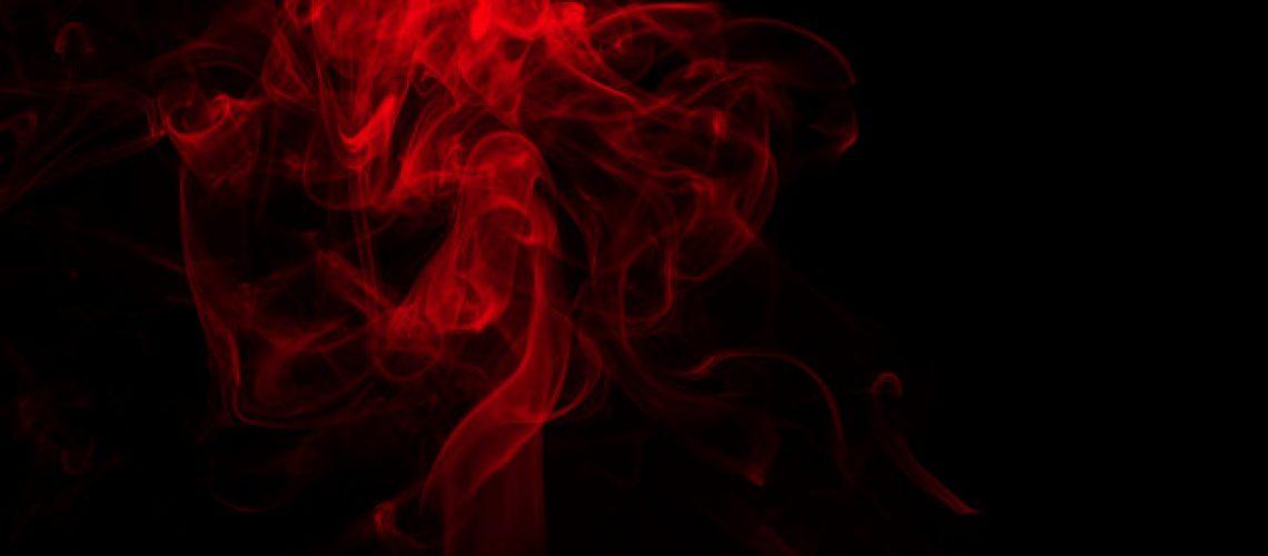fluffy-puffs-red-smoke-fog-black-background-fire-darkness-concept_55716-2694